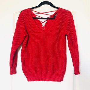 red knit sweater with a crisscross back